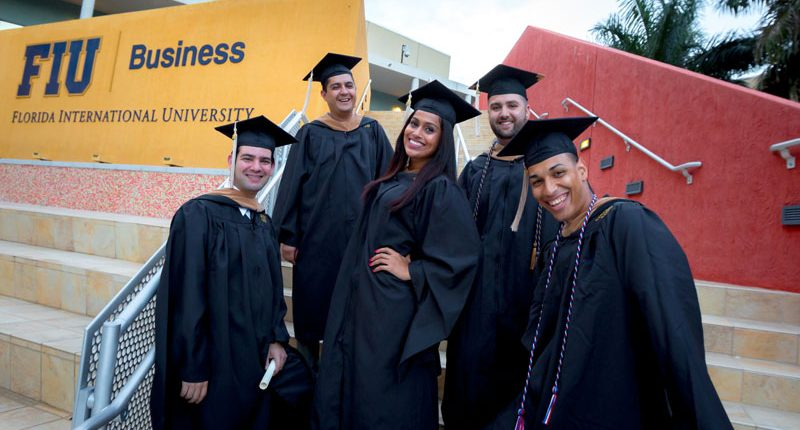 Graduates at the business building